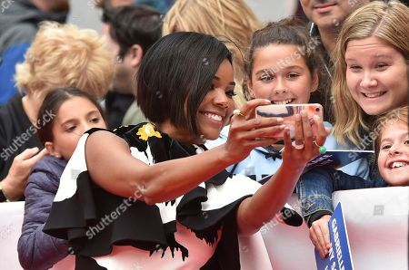 """Gabrielle Union takes a photo with fans as she attends a gala for """"The Public"""" on day 4 of the Toronto International Film Festival at Roy Thomson Hall, in Toronto"""