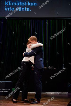 The spokespersons Isabella Lovin (L) and Gustav Fridolin hug each other at the Miljopartiet election party at the Nalen restaurant in Stockholm, Sweden 09 September 2018.