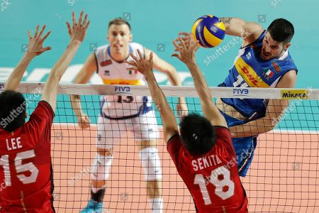 Italy's Filippo Lanza spikes the ball during a Volleyball Men's World Championship match between Italy and Japan, in Rome