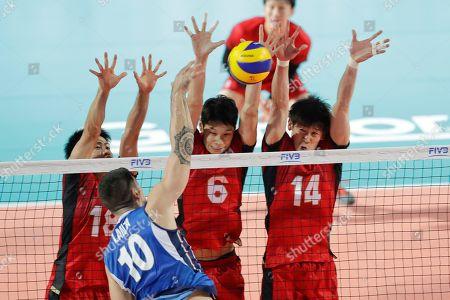 From left, Japan's Masahiro Sekita, Akihiro Yamauchi and Yuki Ishikawa block as Italy's Filippo Lanza spikes the ball during a Volleyball Men's World Championship match between Italy and Japan, in Rome
