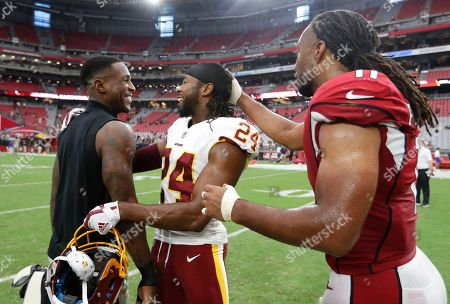 Arizona Cardinals wide receiver Larry Fitzgerald (11), Arizona Cardinals defensive back Patrick Peterson and Washington Redskins defensive back Josh Norman (24) after an NFL football game, in Glendale, Ariz