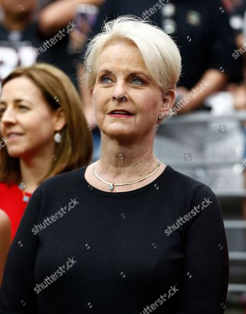 Cindy McCain, wife of the late U.S. Sen. John McCain, stands on the sidelines prior to an NFL football game between the Washington Redskins and the Arizona Cardinals, in Glendale, Ariz
