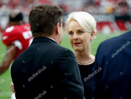 Cindy McCain, wife of the late U.S. Sen. John McCain, talks with Arizona Cardinals president Michael Bidwill prior to an NFL football game between the Washington Redskins and the Arizona Cardinals, in Glendale, Ariz