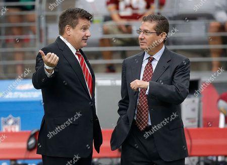 Arizona Cardinals team president Michael Bidwill, left, talks with Washington Redskins owner Daniel Snyder prior to an NFL football game, in Glendale, Ariz