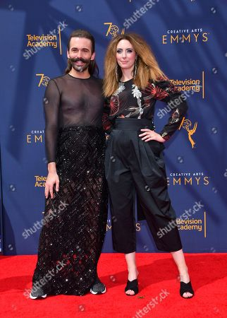 Jonathan Van Ness, Erin Gibson. Jonathan Van Ness, left, and Erin Gibson arrive at night two of the Television Academy's 2018 Creative Arts Emmy Awards at the Microsoft Theater, in Los Angeles