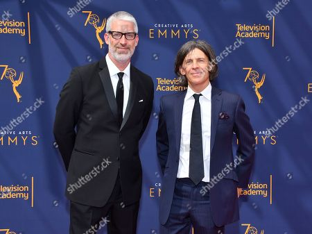 Stock Photo of Mark Monroe, Adam Peters. Mark Monroe, left, and Adam Peters arrives at night two of the Television Academy's 2018 Creative Arts Emmy Awards at the Microsoft Theater, in Los Angeles