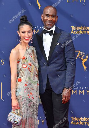Paul Tazewell, Laaleh Mizani. Laaleh Mizani, left, and Paul Tazewell arrive at night two of the Television Academy's 2018 Creative Arts Emmy Awards at the Microsoft Theater, in Los Angeles