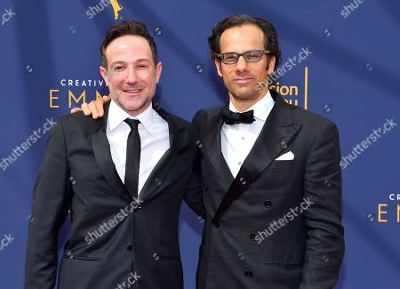 Stock Photo of Bryan Fogel, Dan Cogan. Bryan Fogel, left, and Dan Cogan arrive at night two of the Television Academy's 2018 Creative Arts Emmy Awards at the Microsoft Theater, in Los Angeles