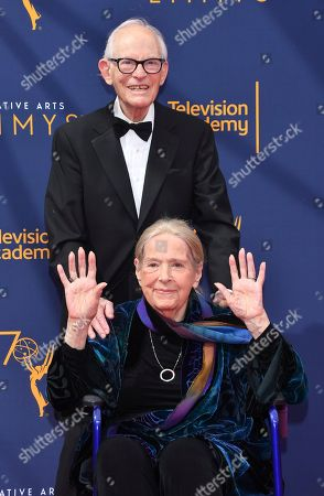 Alan Bergman, Marilyn Bergman. Alan Bergman, back, and Marilyn Bergman arrive at night two of the Television Academy's 2018 Creative Arts Emmy Awards at the Microsoft Theater, in Los Angeles