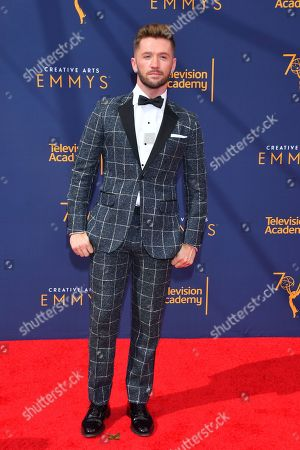 Travis Wall arrives at night two of the Television Academy's 2018 Creative Arts Emmy Awards at the Microsoft Theater, in Los Angeles