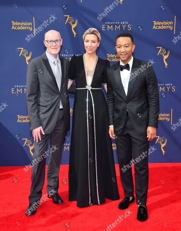 Neil Meron, Ty Stiklorius, John Legend. Neil Meron, from left, Ty Stiklorius and John Legend arrive at night two of the Television Academy's 2018 Creative Arts Emmy Awards at the Microsoft Theater, in Los Angeles