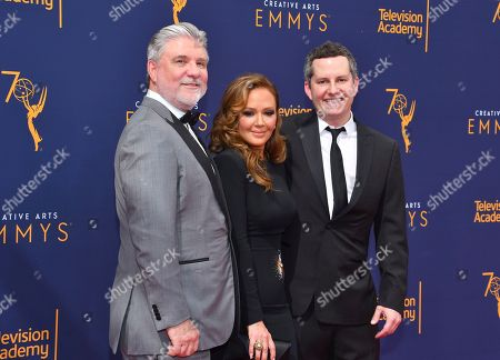 Mike Rinder, Leah Remini, Aaron Saidman. Mike Rinder, from left, Leah Remini and Aaron Saidman arrive at night two of the Television Academy's 2018 Creative Arts Emmy Awards at the Microsoft Theater, in Los Angeles