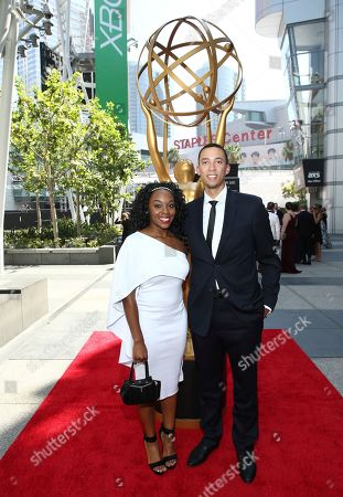 Stock Picture of Marissa Brooks, Michael Jarrett. Marissa Brooks, left, and Michael Jarrett arrive at night two of the Television Academy's 2018 Creative Arts Emmy Awards at the Microsoft Theater, in Los Angeles