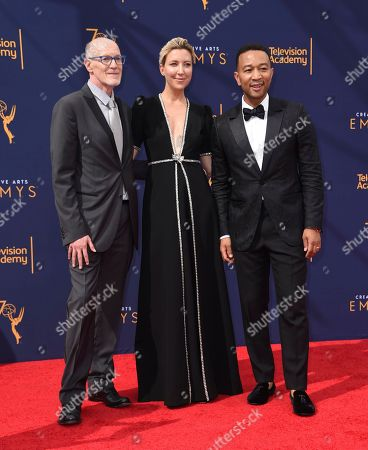 Neil Meron, Ty Stiklorius, John Legend. Neil Meron, from left, Ty Stiklorius, and John Legend arrive at Night 2 of the Creative Arts Emmy Awards at The Microsoft Theater, in Los Angeles