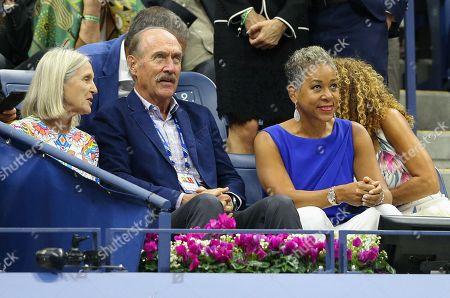 Marjory Gengler, Stan Smith and Katrina Adams watch the Men's Singles final
