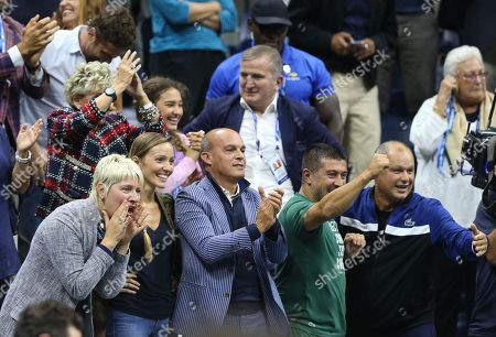 Novak Djokovic's Player's Box celebrate his victory with his wife Jelena (centre) and his head coach Marian Vajda (botton far right)