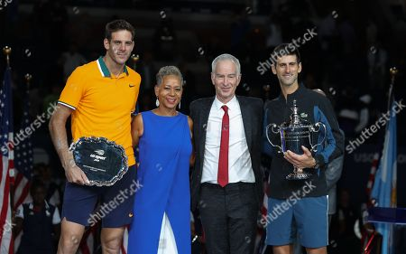 Stock Image of Novak Djokovic and Juan Martin del Potro pose with John McEnroe and Chairman of the Board & President of the USTA Katrina Adams in the presentation ceremony