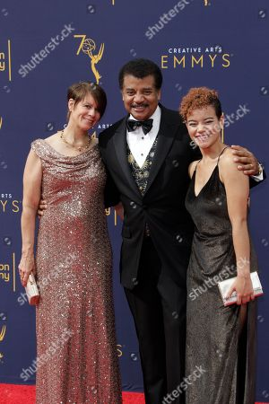 Neil deGrasse Tyson (C), wife  Alice Young (L) and daughter Miranda (R) arrive for the 2018 Creative Arts Emmy Awards at the Microsoft Theater in Los Angeles, California, USA, 09 September 2018. The Creative Arts Emmy Awards honor excellence in Television technical categories such as makeup, casting direction, costume design, editing and cinematography. The 70th Primetime Emmy Awards Ceremony will take place on 17 September 2018.
