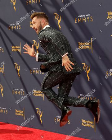 Travis Wall arrives for the 2018 Creative Arts Emmy Awards at the Microsoft Theater in Los Angeles, California, USA, 09 September 2018. The Creative Arts Emmy Awards honor excellence in Television technical categories such as makeup, casting direction, costume design, editing and cinematography. The 70th Primetime Emmy Awards Ceremony will take place on 17 September 2018.