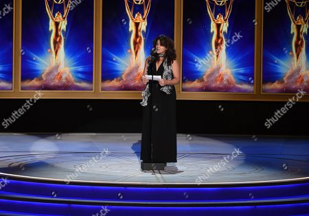"""Lydia Tenaglia accepts the award for outstanding writing for a nonfiction program on behalf of Anthony Bourdain for the """"Southern Italy"""" episode of """"Anthony Bourdain: Parts Unknown"""" during night two of the Television Academy's 2018 Creative Arts Emmy Awards at the Microsoft Theater, in Los Angeles"""