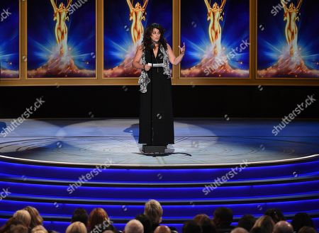 """Stock Picture of Lydia Tenaglia accepts the award for outstanding writing for a nonfiction program on behalf of Anthony Bourdain for the """"Southern Italy"""" episode of """"Anthony Bourdain: Parts Unknown"""" during night two of the Television Academy's 2018 Creative Arts Emmy Awards at the Microsoft Theater, in Los Angeles"""