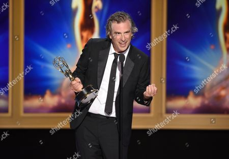 """Brett Morgen accepts the award for outstanding directing for a documentary/nonfiction program for """"Jane"""" during night two of the Television Academy's 2018 Creative Arts Emmy Awards at the Microsoft Theater, in Los Angeles"""