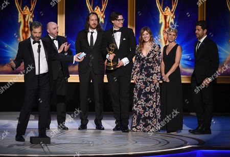 """Judd Apatow, left, and the team from """"The Zen Diaries of Garry Shandling """" accept the award for outstanding documentary or nonfiction special during night two of the Television Academy's 2018 Creative Arts Emmy Awards at the Microsoft Theater, in Los Angeles"""