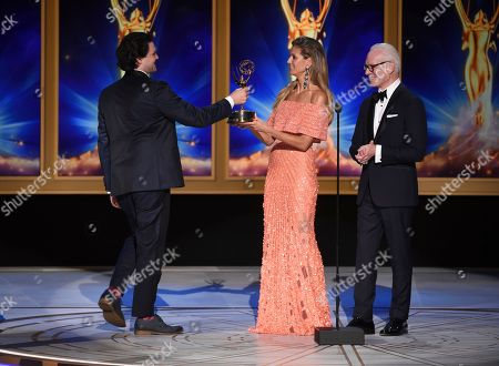"""Maclain Way, Heidi Klum, Tim Gunn. Heidi Klum, center, and Tim Gunn, right, present the award for outstanding documentary or nonfiction series to Maclain Way for """"Wild Wild Country"""" during night two of the Television Academy's 2018 Creative Arts Emmy Awards at the Microsoft Theater, in Los Angeles"""