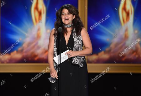 """Stock Image of Lydia Tenaglia accepts the award for outstanding writing for a nonfiction program on behalf of Anthony Bourdain for the """"Southern Italy"""" episode of """"Anthony Bourdain: Parts Unknown"""" during night two of the Television Academy's 2018 Creative Arts Emmy Awards at the Microsoft Theater, in Los Angeles"""