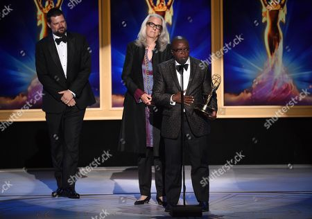 "Joslyn Barnes, Yance Ford. Yance Ford, right, and Joslyn Barnes accept the award for exceptional merit in documentary filmmaking for ""Strong Island"" during night two of the Television Academy's 2018 Creative Arts Emmy Awards at the Microsoft Theater, in Los Angeles"