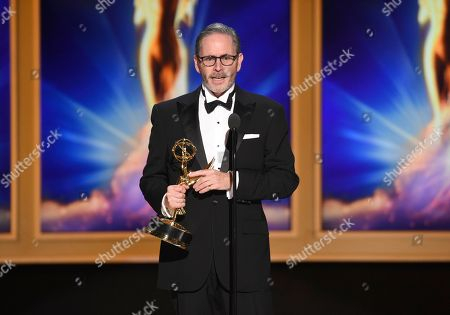 """Keith Ian Raywood accepts the award for outstanding production design for a variety, reality or reality-competition series for """"Saturday Night Live"""" during night two of the Television Academy's 2018 Creative Arts Emmy Awards at the Microsoft Theater, in Los Angeles"""
