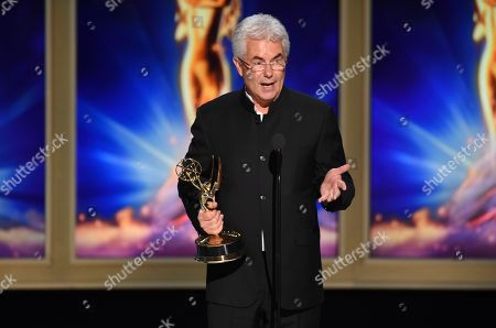 """Gregg Field accepts the award for outstanding music direction for """"Tony Bennett: The Library of Congress Gershwin Prize for Popular Song"""" during night two of the Television Academy's 2018 Creative Arts Emmy Awards at the Microsoft Theater, in Los Angeles"""