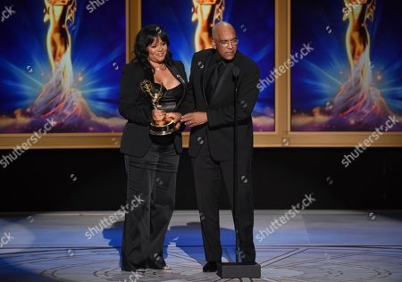"Rikki Hughes, Stan Lathan. Rikki Hughes, left, and Stan Lathan accept the award for outstanding variety special (pre-recorded) for ""Dave Chappelle: Equanimity"" during night two of the Television Academy's 2018 Creative Arts Emmy Awards at the Microsoft Theater, in Los Angeles"