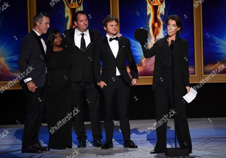 """Kate Kunath, Ed O'Keefe, Nathan Thornburgh, Nitya Chambers, Matt Goulding. The team from """"Anthony Bourdain: Explore Parts Unknown"""" accept the award for outstanding short form nonfiction or reality series for """"Anthony Bourdain: Explore Parts Unknown"""" during night two of the Television Academy's 2018 Creative Arts Emmy Awards at the Microsoft Theater, in Los Angeles"""