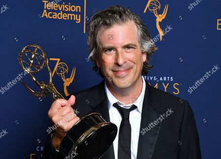 """Stock Photo of Brett Morgen, winner of the award for outstanding directing for a documentary/nonfiction program for """"Jane"""" poses for a portraits during night two of the Television Academy's 2018 Creative Arts Emmy Awards at the Microsoft Theater, in Los Angeles"""