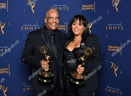 "Stan Lathan, Rikki Hughes. Stan Lathan, left, and Rikki Hughes, winners of the the award for outstanding variety special (pre-recorded) for ""Dave Chappelle: Equanimity"" pose for a portrait during night two of the Television Academy's 2018 Creative Arts Emmy Awards at the Microsoft Theater, in Los Angeles"