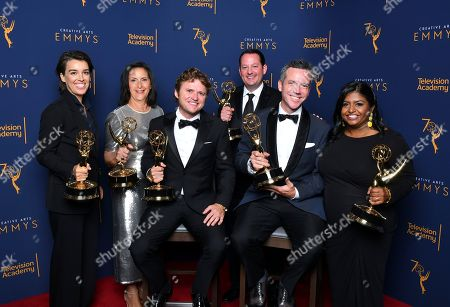 """The team from """"Anthony Bourdain: Explore Parts Unknown"""", winners of the award for outstanding short form nonfiction or reality series pose for a portrait during night two of the Television Academy's 2018 Creative Arts Emmy Awards at the Microsoft Theater, in Los Angeles"""