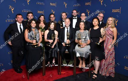 """The team from """"Anthony Bourdain: Parts Unknown"""" winners of the award for outstanding informational series or special pose for a portrait during night two of the Television Academy's 2018 Creative Arts Emmy Awards at the Microsoft Theater, in Los Angeles"""