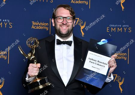 """Hunter Gross, winner of the award for outstanding picture editing for a nonfiction program for the """"Lagos"""" episode of """"Anthony Bourdain: Parts Unknown"""" poses for a portraits during night two of the Television Academy's 2018 Creative Arts Emmy Awards at the Microsoft Theater, in Los Angeles"""