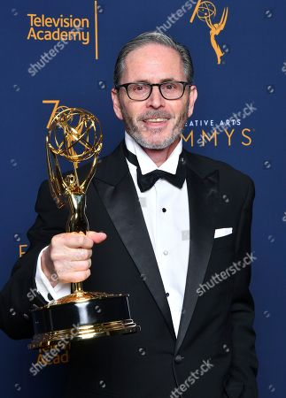 """Keith Ian Raywood, winner of the award for outstanding production design for a variety, reality or reality-competition series for """"Saturday Night Live"""" poses for a portraits during night two of the Television Academy's 2018 Creative Arts Emmy Awards at the Microsoft Theater, in Los Angeles"""