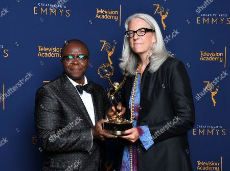 "Yance Ford, Joslyn Barnes. Yance Ford, left, and Joslyn Barnes, winners of the award for exceptional merit in documentary filmmaking for ""Strong Island"" pose for a portrait during night two of the Television Academy's 2018 Creative Arts Emmy Awards at the Microsoft Theater, in Los Angeles"