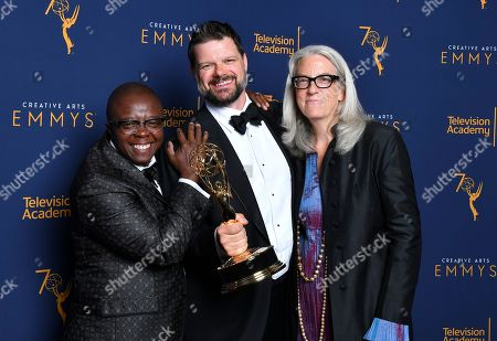 "Yance Ford, Joslyn Barnes, Alan Jacobsen. Yance Ford, from left, Alan Jacobsen and Joslyn Barnes, winners of the award for exceptional merit in documentary filmmaking for ""Strong Island"" pose for a portrait during night two of the Television Academy's 2018 Creative Arts Emmy Awards at the Microsoft Theater, in Los Angeles"
