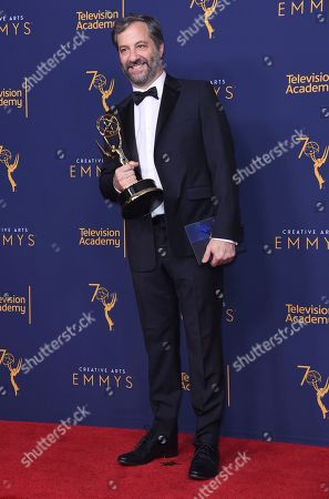 """Stock Picture of Judd Apatow winner of the award for outstanding documentary or nonfiction special for """"The Zen Diaries of Garry Shandling"""" poses in the press room during night two of the Creative Arts Emmy Awards at The Microsoft Theater, in Los Angeles"""