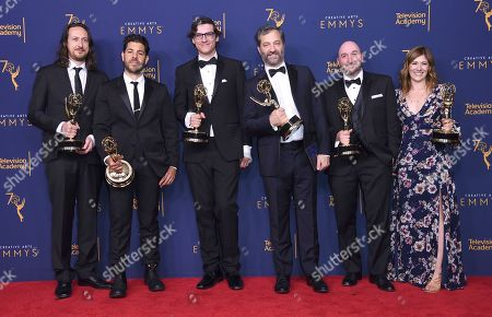 """Stock Photo of Michael Bonfiglio, Joe Beshenkovsky, Sam Fishell, Judd Apatow, Josh Church, Amanda Glaze. Michael Bonfiglio, left, Joe Beshenkovsky, Sam Fishell, Judd Apatow, Josh Church, and Amanda Glaze winners of the award for outstanding documentary or nonfiction special for """"The Zen Diaries of Gary Shandling"""" pose in the press room during night two of the Creative Arts Emmy Awards at The Microsoft Theater, in Los Angeles"""