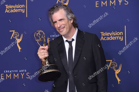 """Brett Morgen winner of the award for outstanding directing for a documentary/nonfiction program for """"Jane"""" poses in the press room during night two of the Creative Arts Emmy Awards at The Microsoft Theater, in Los Angeles"""