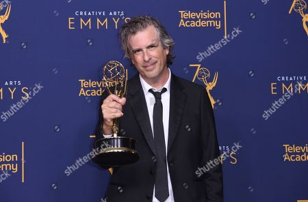 """Stock Image of Brett Morgen winner of the award for outstanding directing for a documentary/nonfiction program for """"Jane"""" poses in the press room during night two of the Creative Arts Emmy Awards at The Microsoft Theater, in Los Angeles"""