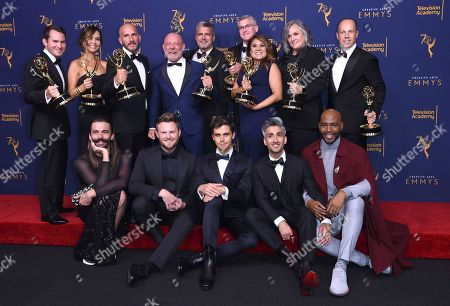 "Jonathan Van Ness, Bobby Berk, Antoni Porowski, Tan France, Kamaro Brown, David George, Jordana Hochman, Rob Eric, David Collins, Michael Williams, David Eilenberg, Rachelle Mendez, Jennifer Lane, Adam Sher. Jonathan Van Ness, from front left, Bobby Berk, Antoni Porowski, Tan France, Kamaro Brown, and David George, from back left, Jordana Hochman, Rob Eric, David Collins, Michael Williams, David Eilenberg, Rachelle Mendez, Jennifer Lane, Adam Sher winners of the award for outstanding structured reality program for ""Queer Eye"" pose in the press room during night two of the Creative Arts Emmy Awards at The Microsoft Theater, in Los Angeles"