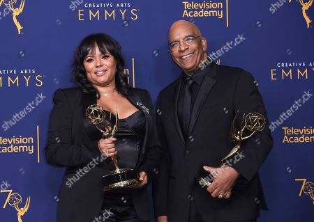 "Rikki Hughes, Stan Lathan. Rikki Hughes, left, and Stan Lathan winners of the award for outstanding variety special (pre-recorded) for ""Dave Chappelle: Equanimity"" pose in the press room during night two of the Creative Arts Emmy Awards at The Microsoft Theater, in Los Angeles"
