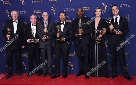 """Tim Rice, Andrew Lloyd Webber, Neil Meron, John Legend, Mike Jackson, Ty Stiklorius, Alex Rudzinski. Tim Rice, left, Andrew Lloyd Webber, Neil Meron, John Legend, Mike Jackson, Ty Stiklorius, and Alex Rudzinski winners of the the award for outstanding variety special for """"Jesus Christ Superstar Live in Concert"""" pose in the press room during night two of the Creative Arts Emmy Awards at The Microsoft Theater, in Los Angeles"""