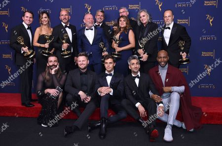"Jonathan Van Ness, Bobby Berk, Antoni Porowski, Tan France, Kamaro Brown, David George, Jordana Hochman, Rob Eric, David Collins, Michael Williams, David Eilenberg, Rachelle Mendez, Jennifer Lane, Adam Sher. Jonathan Van Ness, from front left, Bobby Berk, Antoni Porowski, Tan France, Kamaro Brown, and David George, from back left, Jordana Hochman, Rob Eric, David Collins, Michael Williams, David Eilenberg, Rachelle Mendez, Jennifer Lane, Adam Sher winners of the award for outstanding structured reality program for ""Queer Eye"" pose in the press room during Night 2 of the Creative Arts Emmy Awards at The Microsoft Theater, in Los Angeles"